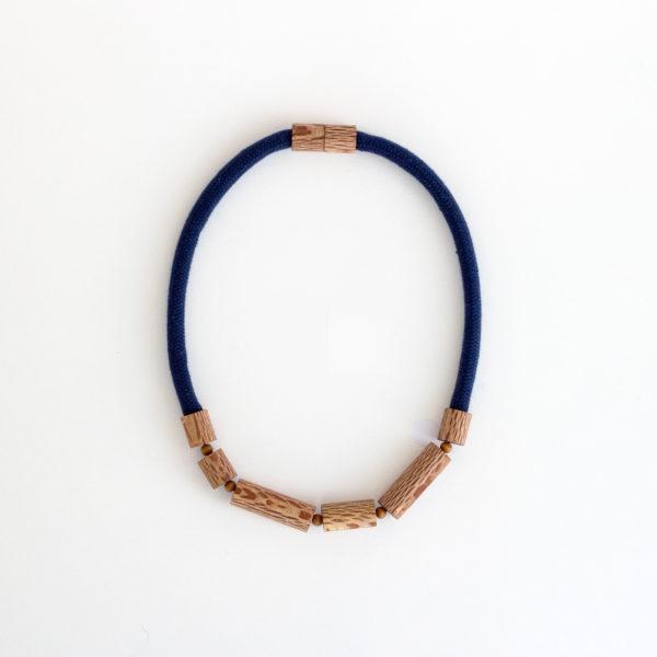 Rewarewa cylinder necklace navy